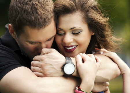 he she: Happy couple in love young man hugging young woman from behind