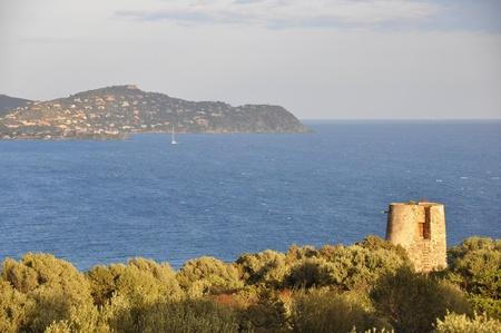shafts: lighthouse in the sardinian evening sun