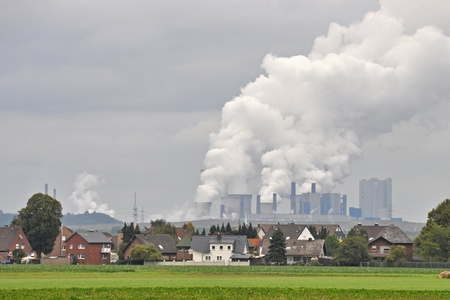 degradation: typical scenery in western germany with village and brown coal power plant Stock Photo