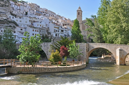 In the valley of the famous city in the rocks Alcala de Jucar in Spain photo