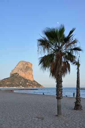 Sunset at the Mediterranian on the beach of Calpe at the spanish Costa Blanca photo