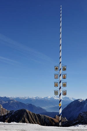Maypole at the Zugspitze glacier withpanoramic view over the Alps