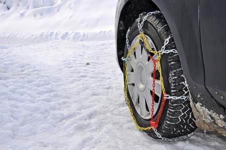 necessary: A car with snow chains in the mountains