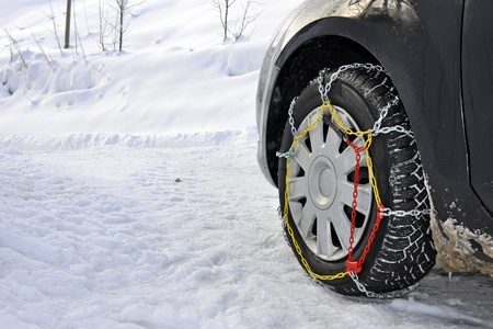 A car with snow chains in the mountains photo