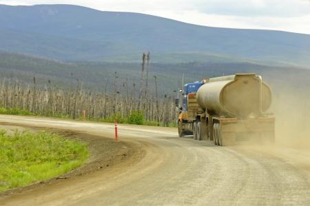 Traffic at the Dalton Gravel Highway in Alaska photo