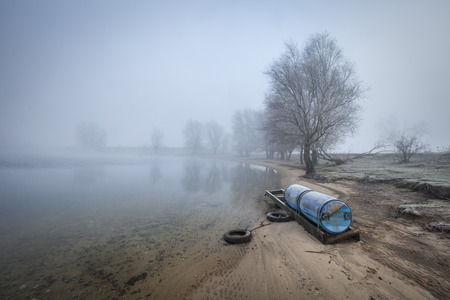 floaters: Hazy view on a bank of the river Maas in the winter Stock Photo