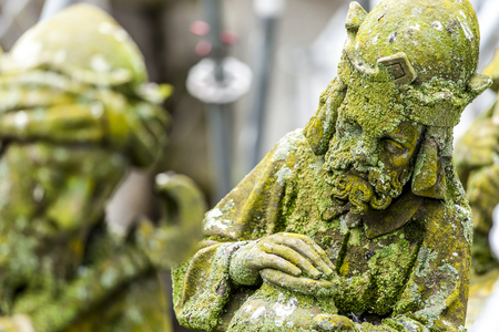 buttresses: Statues of decorative and fantasy figures on the buttresses of St.Jan Cathedral in s-Hertogenbosch, Netherlands. In focus the depiction of king Balthasar.
