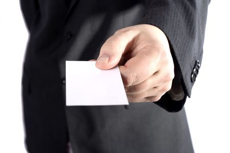 A business man handing out a blank card.