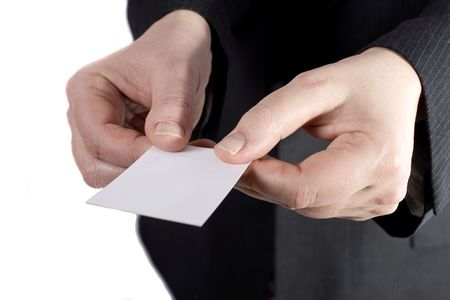 A businessman giving a card the Chinese way (with two hands). Фото со стока
