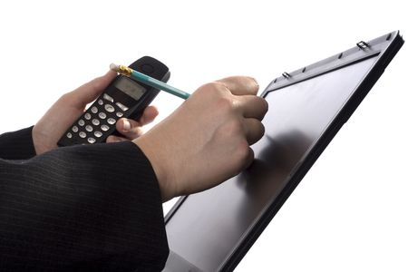 A businessman is writing notes in his agenda on a laptopscreen while holding a mobile phone. Stock Photo - 380379