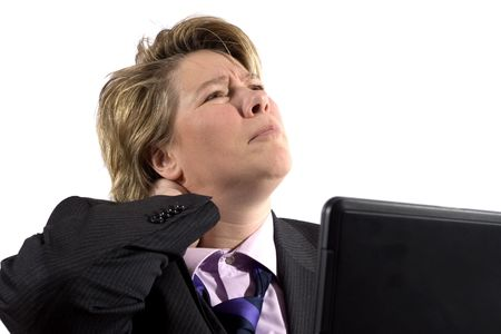 worked: A business woman grabbing her neck in pain. Shes worked to long and hard on the laptop.