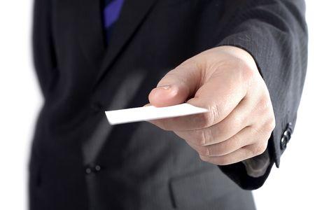 A businessman handing a white card. Фото со стока