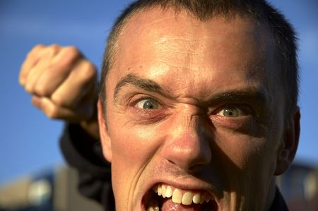 face and fist of a very angry man.face and fist of a very angry man. Stock Photo - 388635