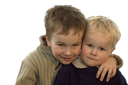 two lovely brothers, 5 and 2 years of age. on white background. Фото со стока
