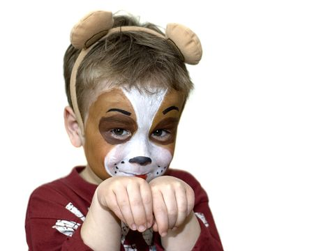 Cute five year old playing dog with a painted face. On white background.