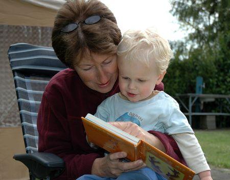 Grandma reading book Фото со стока