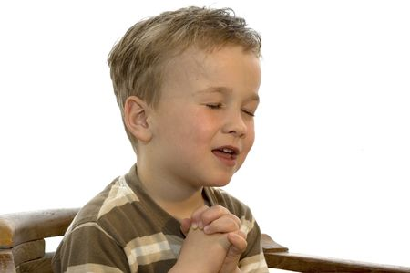 Five year old boy praying and singing photo
