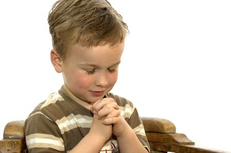 Five year old boy praying photo