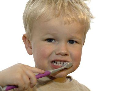 Three year old brushing his teeth Фото со стока