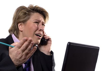 unsatisfied: A businesswoman arguing with her boss over the phone.