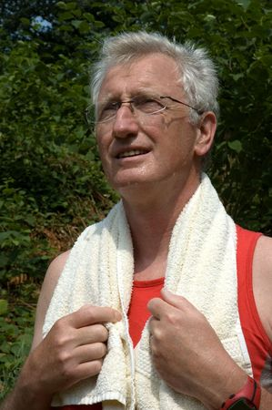 Active senior sweating after a long run Stock Photo