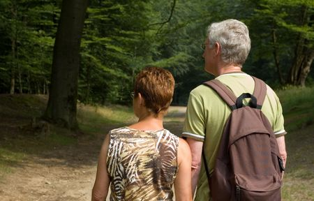 senior couple hiking in the woods
