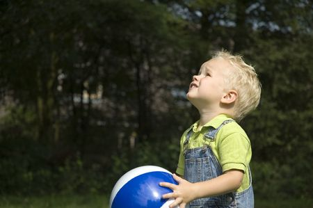 Little boy is going to throw the ball Фото со стока