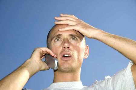 Boy looking surprised on the phone Stock Photo - 600431