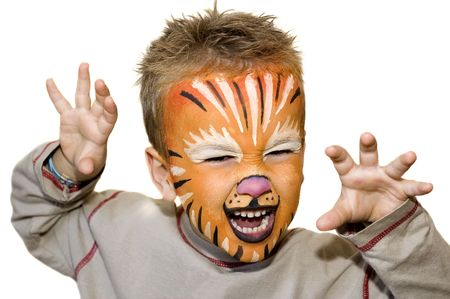 Kid with lion painted face. On white background. Фото со стока