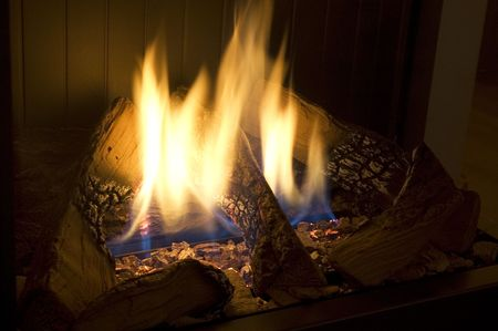 Picture of a cosy and warm fireplace. Long shutterspeed. Stock Photo - 714722