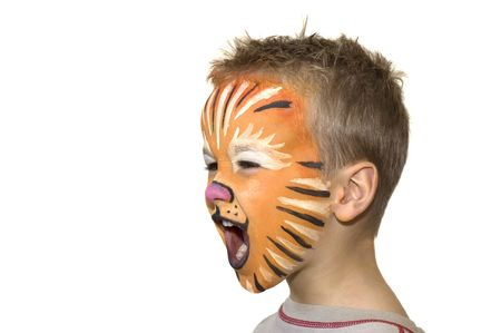 Little 5 year old yelling and screaming. Face-painted as a lion. photo