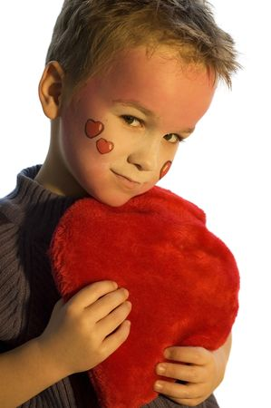 Lovely boy with painted heart face. Use it for valentine designs or just as a love picture.