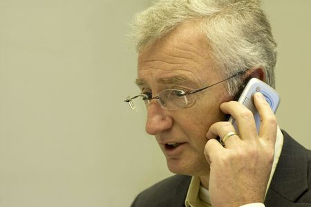 Senior consultant making a business call to his boss Stock Photo - 753171