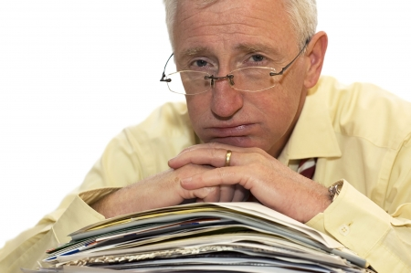 much: An exhausted businessman has had too much of his paperwork. Stock Photo