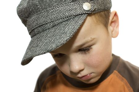 Little boy looking down thinking about something. He's not too happy. On white background. Stock Photo - 898542