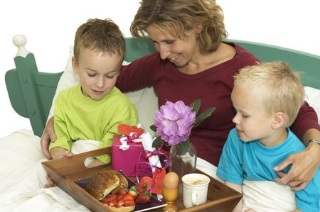 nice food: Family celebrating Mothers Day with a full plate of nice food and presents. Фото со стока