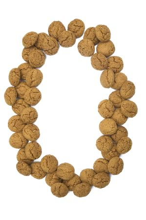 pepernoot: Little ginger nuts in the form of the digit zero. These little ginger nuts are used in Holland for the  Stock Photo