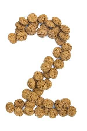 ginger nuts: Little ginger nuts in the form of the digit two. These little ginger nuts are used in Holland for the
