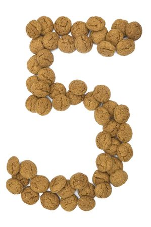 pepernoot: Little ginger nuts in the form of the digit five. These little ginger nuts are used in Holland for the  Stock Photo