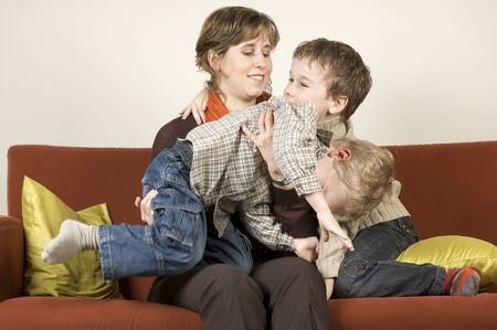 pranks: Family playing pranks on a couch.