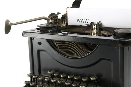 An old ancient typewriter is used to type an internet address. Isolated on white.