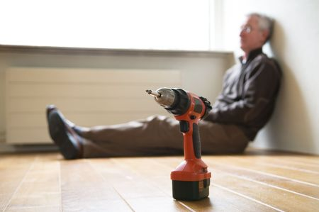Senior man is tired after moving out of his house. Finally the work is done. Stock Photo - 2689288
