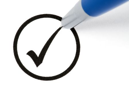 Pencil making a check sign in a circled box. Isolated on white. Stock Photo