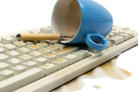 function key: The coffee mug just felt over my keyboard. Isolated on white.  Stock Photo
