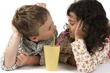 Boy and a girl drinking together with a straw. photo
