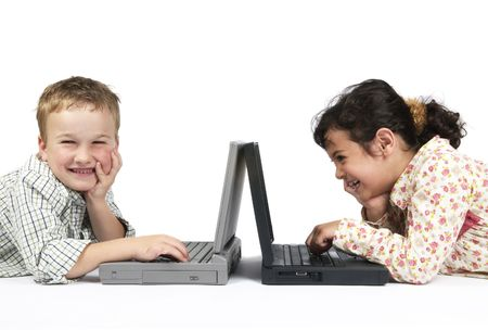 Two kids doing their schoolwork on a laptop. It's a funny exercise... photo