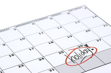 It is finally holiday! Marked and written holiday in a calendar. photo