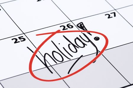finally: It is finally holiday! Marked and written holiday in a calendar. Stock Photo