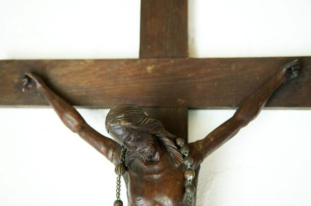 Jesus hanging on a wooden cross. photo