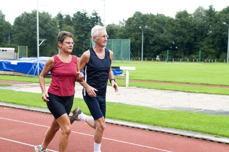 Two running pensioners having a healthy lifestyle. photo